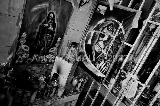 Nuevo Laredo, Mexico<br /> June 7, 2007<br /> <br /> Thirty kilometers south of Nuevo Laredo, a United States border town, there is a large shrines erected for Santa Muerte (Saint of Death), the patron saint of lost and desperate causes, and a favorite among drug traffickers. The shrines here is often visited and respected by drug traffickers from Nuevo Laredo a town that has seen some of the most extreme violence and murder in the past few years.