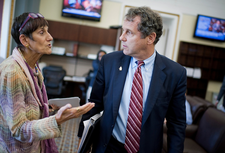 UNITED STATES - SEPTEMBER 14:  Rep. Rosa DeLauro, D-Conn., and Sen. Sherrod Brown, D-Ohio, talk after a news conference in the Senate Print Gallery to introduce the Fix America's Schools Today (FAST) Act, which would create construction jobs and repair and modernize schools.  (Photo By Tom Williams/Roll Call)