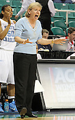 UNC coach Sylvia Hatchell directs her team from the sideline. This game was one of the two Semifinal games of the 2011 ACC Tournament in Greensboro on Saturday, March 5, 2011. UNC beat Miami 83-57. (Photo by Al Drago)