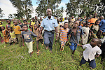 Jacques Umembudi Akasa, a United Methodist missionary pilot for Wings of Caring Aviation, a program of the United Methodist Church in the Democratic Republic of the Congo, is welcomed to the village of Minga by children who ran to the airstrip to greet his plane.