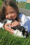 Seven-year old Madisson Foster enjoys some time with her Satin.rabbit, Bun-Bun.
