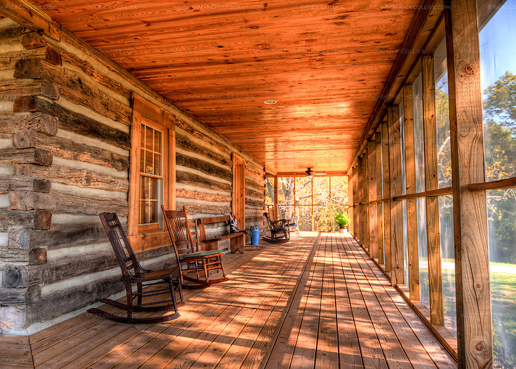 Rocking chairs on the wrap-around screened porch invite visitors to stay a while at The Homeplace Vineyard (HDR image).