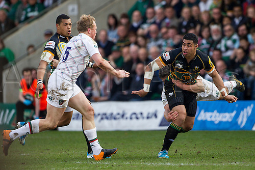 29.03.2014.  Northampton, England.  Luther BURRELL of Northampton Saints makes the pass as Anthony ALLEN of Leicester Tigers come in for a flying tackle during the Aviva Premiership match between Northampton Saints and Leicester Tigers at Franklin's Gardens.  Final score: Northampton Saints 16-22 Leicester Tigers.