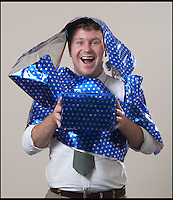BNPS.co.uk (01202 558833)<br /> Pic: PeterWillows/BNPS<br /> <br /> So simple, even (most) men can do it...<br /> <br /> The answer to every males gift wrapping nightmares - Man Wrap.<br /> <br /> An easy-to-use type of wrapping paper has been invented just for men in a bid to get them to start presenting neatly covered gifts.<br /> <br /> The blue, star patterned gift-wrap can be used without scissors or sellotape and can cover an item in seconds.<br /> <br /> Users simply have to roll out the paper and place their gift in the centre, tear off a strip and then twist it around the present to secure it in place.<br /> <br /> It was created by designer Martin Grix who was shocked at the sheer amount of men he heard found the wrapping process difficult and were even resorting to using bin liners.<br /> <br /> He came up with the unique roll of paper, 'Man Wrap', as a solution in the hope that it would encourage men to start covering their gifts.<br /> <br /> The tube of decorative paper provides 16ft of gift-wrap with a width of 8ins to coat small presents such as boxes and bottles.<br /> <br /> It costs 4.99 pounds from www.themonsterfactory.com