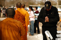 A US Army veteran bows to honor Buddhist monks on their way to collect donations during an Asian New Year festival, Sunday, Jan. 25, 2009, at Lien Hoa Vietnamese Buddhist temple in San Antonio. (Darren Abate/pressphotointl.com)