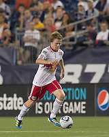 New York Red Bulls midfielder Dax McCarty (11) brings the ball forward. In a Major League Soccer (MLS) match, the New England Revolution tied New York Red Bulls, 2-2, at Gillette Stadium on August 20, 2011.