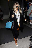 Fergie ( pregnant ) arriving at the Los Angeles International airport
