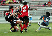 BOYDS, MARYLAND - July 21, 2012:  Holly King (16) of DC United Women pokes the ball past Marbel Egwuenu (0) of the Virginia Beach Piranhas during a W League Eastern Conference Championship semi final match at Maryland Soccerplex, in Boyds, Maryland on July 21. DC United Women won 3-0.