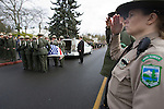 Washington State Park Service Rangers salute the casket of National Park Service Ranger Margaret Anderson during a memorial service at the Pacific Lutheran University in Tacoma on January 10, 2010. Anderson was slain at Mount Rainier on New Years' Day when she set up a road block to intercept a vehicle, driven by Benjamin Barnes, who failed to stop at a chain-up checkpoint.  Barnes, the suspect  in the shooting was found dead was found dead the next day. He had drown in Paradise Creek.   ©2012. Jim Bryant Photo. All RIGHTS RESERVED.