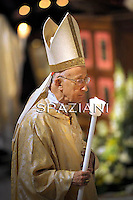 Cardinal Camillo Ruini;Pope Benedict XVI holds a candle during the Easter vigil mass in Saint Peter's Basilica, in the Vatican, late  April 23, 2011