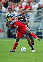 August 21 2010 New York Red Bulls forward Thierry Henry #14 and Toronto FC defender Nana Attakora #3 in action during a game between the New York Red Bulls and Toronto FC at BMO Field in Toronto..The New York Red Bulls won 4-1
