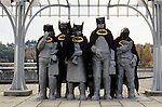 "Fremont statues ""Waiting for the Interurban"" Artist Richard Beyer with statues dressed up like batman Fremont neighborhood Seattle Washington State USA"