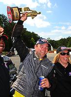 May 6, 2012; Commerce, GA, USA: NHRA super comp driver Dave Connolly celebrates after winning the Southern Nationals at Atlanta Dragway. Mandatory Credit: Mark J. Rebilas-