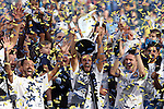 07 December 2014: Los Angeles's Landon Donovan (center) with Marcelo Sarvas (BRA) (left) and Robbie Keane (IRL) (right) lifts the Philip F. Anschutz trophy overhead. The Los Angeles Galaxy played the New England Revolution in Carson, California in MLS Cup 2014. Los Angeles won 2-1 in overtime.