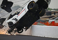 Apr 29, 2016; Baytown, TX, USA; NHRA  pro mod driver Sidnei Frigo crashes during qualifying for the Spring Nationals at Royal Purple Raceway. Frigo was alert and transported via helicopter to a local hospital. Mandatory Credit: Mark J. Rebilas-USA TODAY Sports