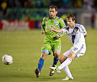 CARSON, CA - November 11, 2012: Seattle Sounder midfielder Christian Tiffert (13) and LA Galaxy midfielder Mike Magee (18) during the LA Galaxy vs the Seattle Sounders at the Home Depot Center in Carson, California. Final score LA Galaxy 3, Seattle Sounders 0.