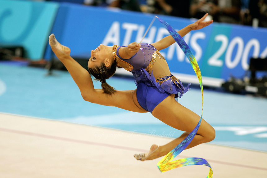 Almudena Cid of Spain stag leaps with ribbon at 2004 Athens Olympic Games during qualifications on August 27, 2006 at Athens, Greece. (Photo by Tom Theobald)