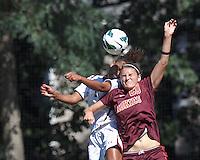Boston College defender Casey Morrison (3) and Virginia Tech forward Murielle Tiernan (20) battle for head ball. Virginia Tech (maroon) defeated Boston College (white), 1-0, at Newton Soccer Field, on September 22, 2013.