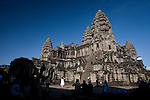 Tourists visit and climb up the stairs inside the ancient temple of Angkor Wat, a UNESCO World Heritage Site in northwestern Cambodia.