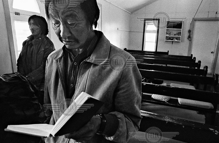 An Inuit man attends Holy Communion at the St. Edmund's Anglican Church in Kuujjuraapik.