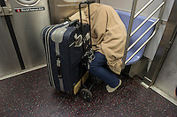 Homeless man escapes the cold and sleeps in a subway car in New York on Saturday, December 29, 2012. Weather for New Year's Eve is expected to be in the low thirties and dry. (© Richard B. Levine)