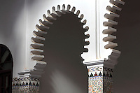 Pillars with zellige tile decoration and fluted horseshoe arches around the central courtyard, in a typical Tetouan riad, a traditional muslim house built around a courtyard, built in Moorish style with strong Andalusian influences, next to the Great Mosque or Jamaa el Kebir in the Medina or old town of Tetouan, on the slopes of Jbel Dersa in the Rif mountains of Northern Morocco. Tetouan was of particular importance in the Islamic period from the 8th century, when it served as the main point of contact between Morocco and Andalusia. After the Reconquest, the town was rebuilt by Andalusian refugees who had been expelled by the Spanish. The medina of Tetouan dates to the 16th century and was declared a UNESCO World Heritage Site in 1997. Picture by Manuel Cohen
