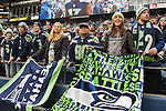 Seattle Seahawks fan cheer during their game agains the Cleveland Browns at CenturyLink Field in Seattle, Washington on December 20, 2015. The Seahawks clinched their fourth straight playoff berth in four seasons by beating the Browns 30-13.  ©2015. Jim Bryant Photo. All Rights Reserved.