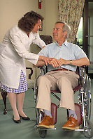 Female health care worker and man in nursing home