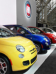 Colorful Fiat 500 small city cars at auto show