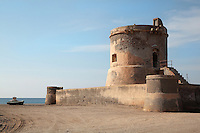 The San Miguel Tower, or Torreon de San Miguel, an 18th century watchtower in San Miguel, in the Cabo de Gata-Nijar Natural Park, Almeria, Andalusia, Southern Spain. It was built by order of Fernando VI in 1756 to protect Almadraba de Monteleva and its valuable salt flats. The park includes the Sierra del Cabo de Gata mountain range, volcanic rock landscapes, islands, coastline and coral reefs and has the only warm desert climate in Europe. The park was listed as a UNESCO Biosphere Reserve in 1997 and a Specially Protected Area of Mediterranean Importance in 2001. Picture by Manuel Cohen