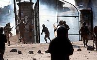 Paramilitary police and  stone throwing youth clash following Friday prayer at the Jamia Masjid.  Srinagar, Kashmir, India.  Fredrik Naumann/Felix Features