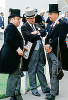 Racegoers chatting in front of the Grandstand at Epsom Racecourse on Derby Day, UK