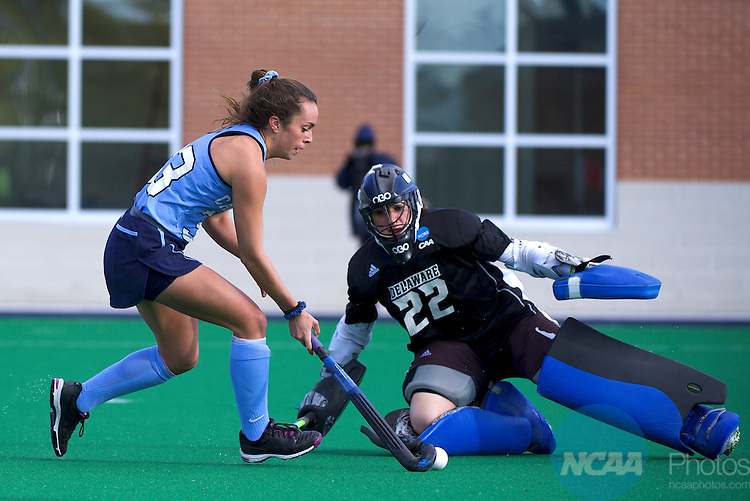 NORFOLK, VA - NOVEMBER 20:  Goalie Emmeline Oltmans (22) of the University of Delaware blocks a shot on goal by Marissa Creatore (33) of the University of North Carolina during the Division I Women's Field Hockey Championship held at the LR Hill Sports Complex on November 20, 2016 in Norfolk, Virginia.  Delaware defeated North Carolina 3-2 for the national title. (Photo by Jamie Schwaberow/NCAA Photos via Getty Images)