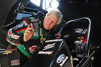 May 18, 2012; Topeka, KS, USA: NHRA funny car driver John Force (left) gives advice to daughter Courtney Force during qualifying for the Summer Nationals at Heartland Park Topeka. Mandatory Credit: Mark J. Rebilas-
