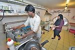Moshaid Ali and his daughter Lutfa work in the kitchen of the small restaurant they run in Budapest, Hungary. Refugees from Bangladesh, they came to Hungary in 2013, were granted refugee status, and opened the restaurant in 2014.<br /> <br /> As Hungary dealt with a massive flow of new refugees in 2015, the country wrestled with its responsibility to the newcomers. Yet old-timers like the Ali family report they have felt welcomed during the years they have lived in Hungary.