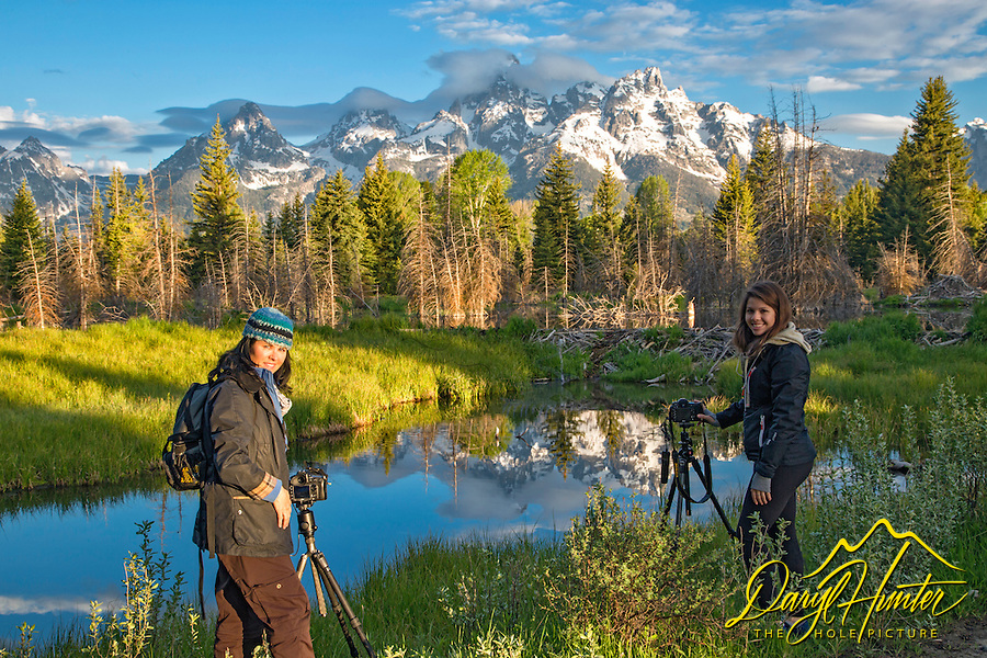 Eleanore and Bella photographing the beaver dam and Grand Tetons at Shwabacker's Landing in Jackson Hole, Wyoming