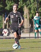 Brown University midfielder Kevin Gavey (12) brings the ball forward. Brown University (black) defeated Boston College (white), 1-0, at Newton Campus Field, October 16, 2012.