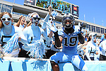 07 September 2013: UNC players, including Nick Weiler (19) jump into the stands before the game. The University of North Carolina Tar Heels played the Middle Tennesse State University Blue Raiders at Keenan Stadium in Chapel Hill, NC in a 2013 NCAA Division I Football game. UNC won the game 40-20.