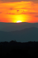 The sun sets over the Blue Ridge mountains as seen from Albemarle County, Va.  Photo/Andrew Shurtleff