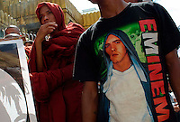 A man in an Eminem T-shirt joins Buddhist monks on a protest march calling for the overthrow of the country's military junta.