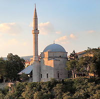Koski Mehmed Pasha mosque, built 1618, in Mostar, Bosnia and Herzegovina. The town is named after the mostari or bridge keepers of the Stari Most or Old Bridge. Mostar developed in the 15th and 16th centuries as an Ottoman frontier town and is listed as a UNESCO World Heritage Site. Picture by Manuel Cohen