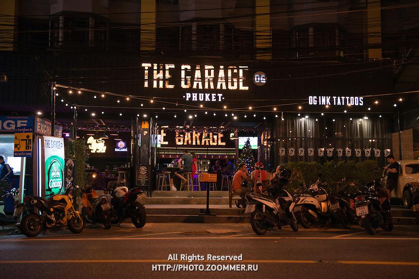 Garage bar sign at night in Karon beach, Phuket, Thailand