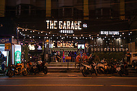 Garage bar sign at night in Karon beach, Phuket, Thailand