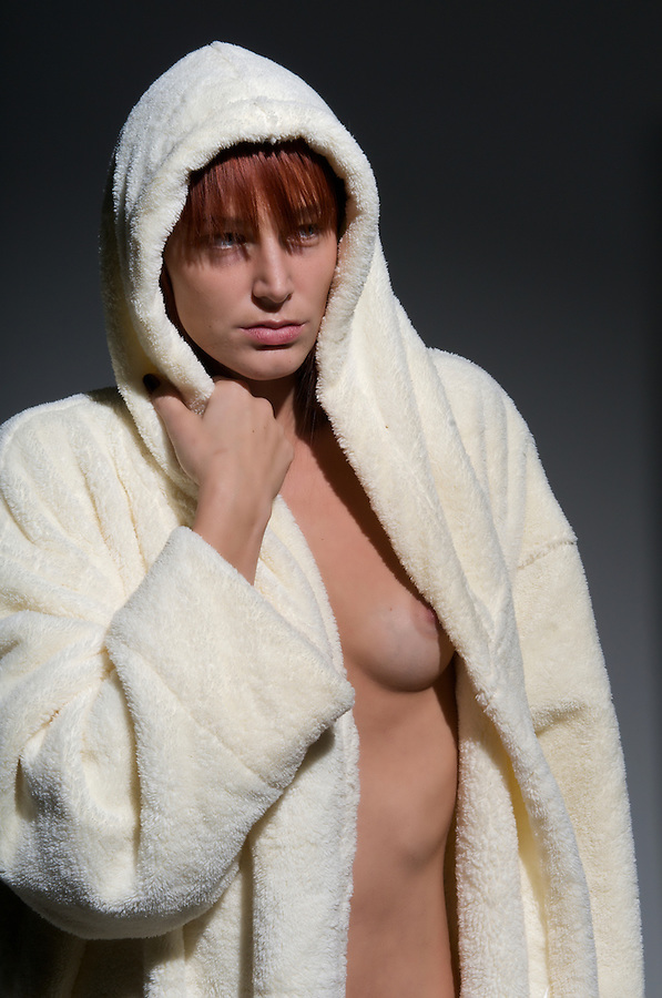 Young caucasian  woman with robe after taking a shower nude.