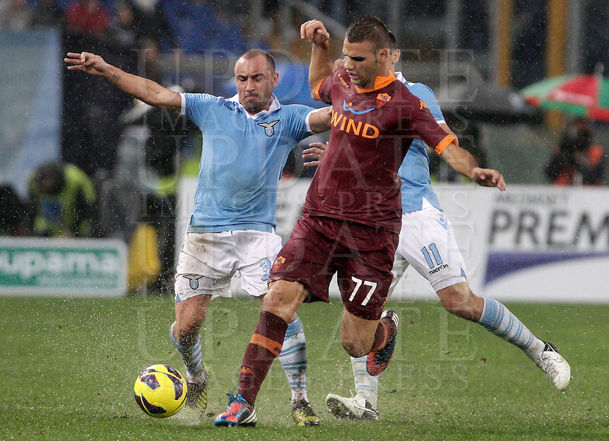 Calcio, Serie A: Lazio vs Roma. Roma, stadio Olimpico, 11 novembre 2012..Lazio midfielder Cristian Brocchi is challenged by AS Roma midfielder Panagiotis Tachtsidis, of Greece, right, during the Italian Serie A football match between Lazio and AS Roma, at Rome's Olympic stadium, 11 November 2012..UPDATE IMAGES PRESS/Riccardo De Luca