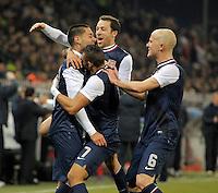 GENOVA, ITALY - February 29, 2012: Clint Dempsey (l, USA) celebrates his goal during the USA friendly match against Italy at the Stadium Luigi Ferraris in Genova, Italy.