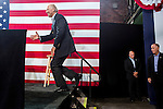 Vice President Joe Biden climbs on stage at a campaign rally at the Port of Burlington during a two-day campaign swing through Iowa on Monday, September 17, 2012 in Burlington, IA.