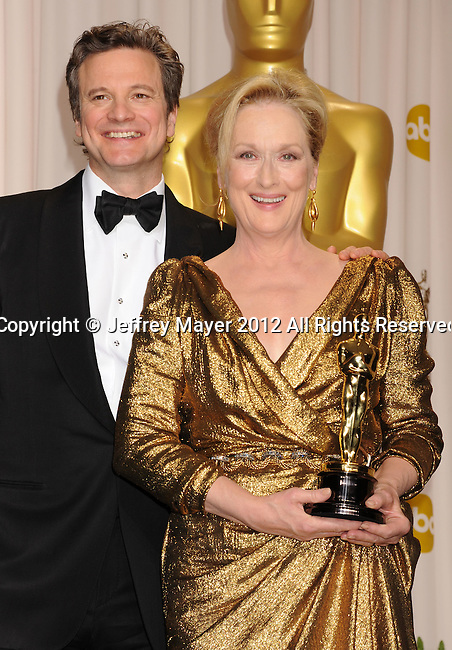 HOLLYWOOD, CA - FEBRUARY 26: Colin Firth and Meryl Streep pose in the press room at the 84th Annual Academy Awards held at Hollywood & Highland Center on February 26, 2012 in Hollywood, California.