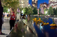 People gather at the 9/11 Memorial to watch the Tribute in Light in New York on September 11, 2014 for the13th anniversary of the September 11, 2001 terrorist attacks. (© Richard B. Levine)