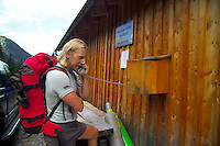 Adlerweg, Tirol, Austria, August 2005. Mountainguide Harry Riedl calls for the luggage lift to the Hanauer Hutte. The Adlerweg (eagles trail) is the new long distance hiking trail in Austria. The Adlerweg connects existing paths throughout Tirol, in the shape of an eagle, Tirol's provincial symbol. Photo by Frits Meyst/Adventure4ever.com